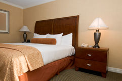 Hotel room with queen bed Stock Photography