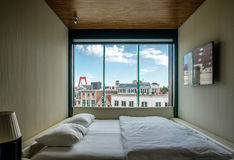 Hotel room with Rotterdam city cityscape skyline with Willemsbrug bridge in window Stock Photography