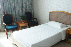 The hotel room single bed Royalty Free Stock Photography