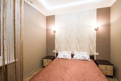Hotel room. Small bedroom with double bed Stock Images