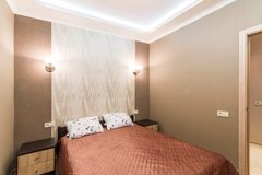 Hotel room. Small bedroom with double bed Royalty Free Stock Photo