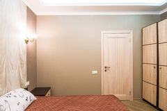 Hotel room. Small bedroom with double bed Stock Photo