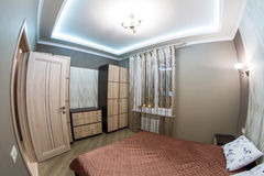 Hotel room. Small bedroom with double bed Royalty Free Stock Image