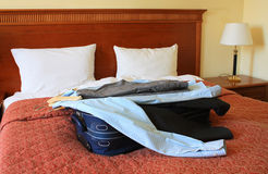 Hotel room with suitcase and clothes Royalty Free Stock Image