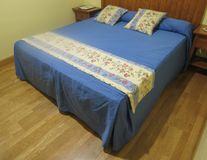 Hotel room in Toledo. TOLEDO, SPAIN - CIRCA OCTOBER 2017: double bed hotel room in Spanish hotel Royalty Free Stock Photos