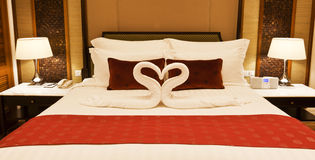 Hotel room with towel forming heart shape Royalty Free Stock Images