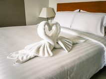 Free Hotel Room Towels In Swan Shapes, Towel Art, Maid Service Royalty Free Stock Photography - 127602307