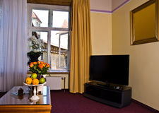 Hotel room with TV. Interior of a luxurious hotel with widescreen LCD television Stock Image