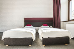 Hotel room with two single beds Stock Image