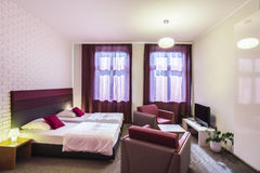 Hotel room with two single beds Stock Images