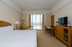 Hotel Room. View of a king sized bed in a hotel room stock image