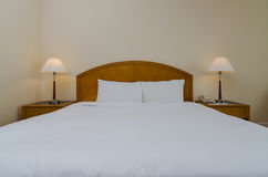 Hotel Room. View of a king sized bed in a hotel room Royalty Free Stock Photo