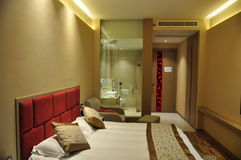 Hotel room. A hotel room with washroom and a large bed Royalty Free Stock Photos