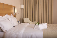 Hotel room and white flowers Stock Image