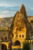 Hotel rooms cut down in the rock. In the light of the setting sun. Cappadocia, Turkey Royalty Free Stock Images