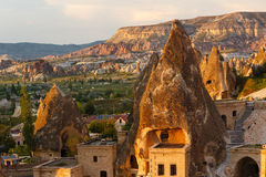 Hotel rooms cut down in the rock. In the light of the setting sun. Cappadocia, Turkey Stock Images