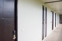 The hotel's long corridor. With doors and ventilation grilles royalty free stock image