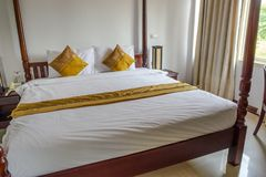 Hotel`s room and bad in Vientiane laos. Vientiane capital / Laos - 13 march, 2018: On my way to meeting, AV hotel is a choice service for room, bus ticket Stock Image