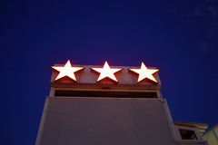 Hotel's three stars. The sign indicates the category tourist hotel as three stars Royalty Free Stock Photography