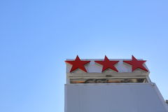 Hotel's three stars. The sign indicates the category tourist hotel as three stars Royalty Free Stock Photos