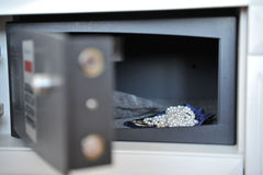 Hotel safe and jewelery. An open hotel safe or strongbox with valuable jewelery inside Stock Photo