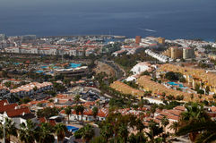 Hotel Scenery with Ocean, Tenerife. Panoramic view to south of Tenerife, Spanish Canaries. Image shows different hotels in the front an blue ocean in the Stock Photos