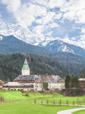 Hotel Schloss Elmau palace vertical landscape. Klais, Germany - April 26, 2015: Hotel Schloss Elmau palace in Bavarian Alps will be the site of the 41st Royalty Free Stock Photo