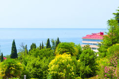 Hotel by the sea. Surrounded by beautiful trees Royalty Free Stock Images