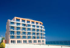 Hotel at the seaside. Hotel projected over blue summer sky at the sea shore Stock Photo