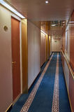 Hotel or Ship Corridor with doors to rooms Stock Photography