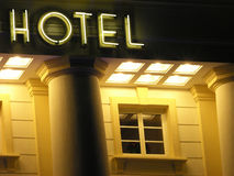Hotel sign. Illuminated on exterior of modern building at night royalty free stock photos