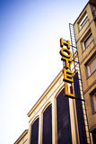 Hotel sign. Yellow hotel sign and facade of the building Royalty Free Stock Photos