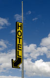 Hotel sign. Directional hotel sign with blue sky and cloudscape background Royalty Free Stock Images