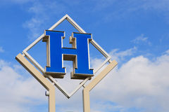 Hotel sign. On blue sky background Stock Photography