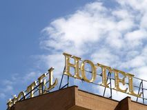 Hotel sign. Against a clear sky on a sunny day Stock Photos