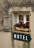 Hotel sign. Sign pointing to hotel in old window Stock Photo
