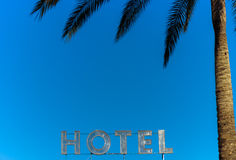 Hotel sign. In the air with palm tree and leaves,tropical holidays Royalty Free Stock Photography