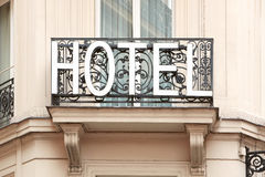 Hotel sign on balcony in the morning Royalty Free Stock Image