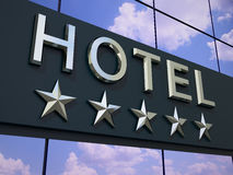 The hotel sign. The hotel with a five stars sign on the modern building facade stock illustration