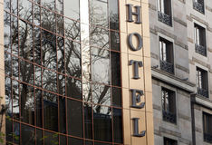 Hotel Sign Glass Reflections. A hotel sign and reflections in the glass of the building Royalty Free Stock Photo
