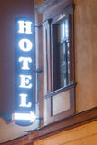 Hotel sign illuminated at night Stock Photos