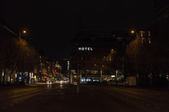 Hotel sign illuminated at night on a street of Berlin, Germany Royalty Free Stock Image