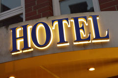 Hotel sign. Illuminated hotel sign taken at dusk Royalty Free Stock Photography