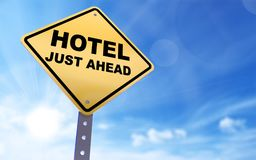 Hotel sign. Hotel just ahead sign on blue sky background,3d rendered stock illustration