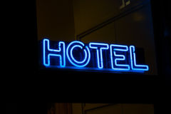 Hotel sign neon on the wall Stock Photography