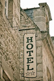 Hotel Sign on Old Stone Building Royalty Free Stock Photography