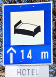 Hotel sign on the road Royalty Free Stock Photos