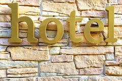 Hotel Sign on Stone Tiled Wall Royalty Free Stock Photography