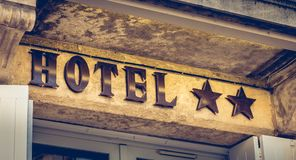 Hotel sign on a stone wall with two stars Stock Image