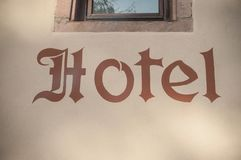 Hotel sign on stoned wall. Closeup of hotel sign on stoned wall Royalty Free Stock Images